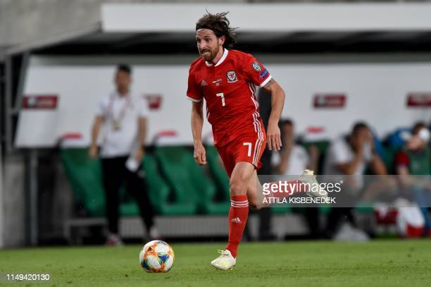 Wales' midfielder Joe Allen runs with the ball during the UEFA Euro 2020 qualifier Group E football match Hungary against Wales on June 11 2019 in...