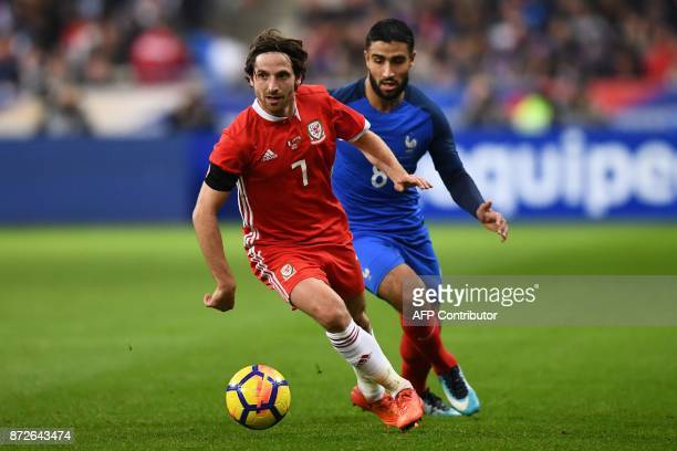 Wales' midfielder Joe Allen vies for the ball with France's forward Nabil Fekir during the friendly football match between France and Wales at the...