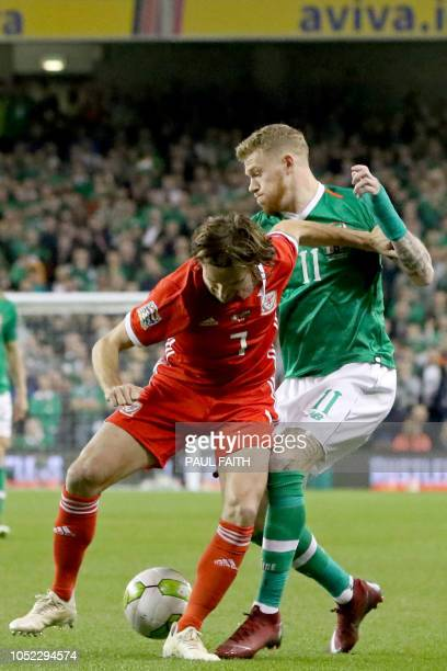 Wales' midfielder Joe Allen vies with Republic of Ireland's midfielder James McClean during the UEFA Nations League football match between Republic...