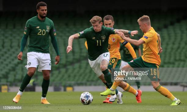 Wales' midfielder Joe Morrell vies with Republic of Ireland's midfielder James McClean during the UEFA Nations League Group B4 football match between...