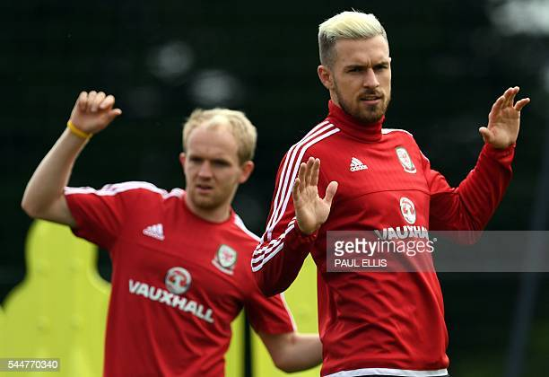Wales' midfielder Jonathan Williams and Wales' midfielder Aaron Ramsey take part in a training session in Dinard on July 04 2016 during the Euro 2016...