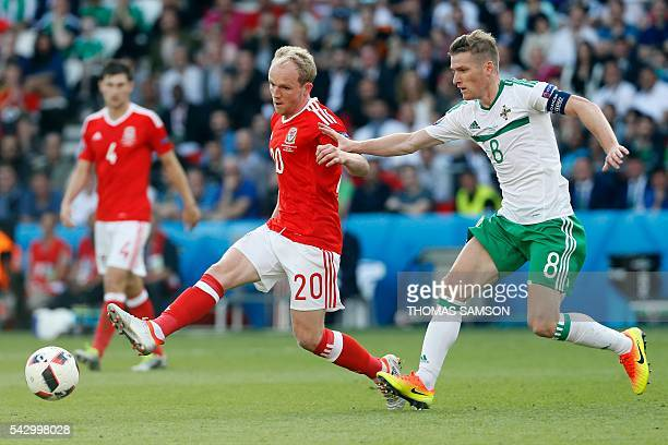 Wales' midfielder Jonathan Williams is marked by Northern Ireland's midfielder Steven Davis during the Euro 2016 round of sixteen football match...