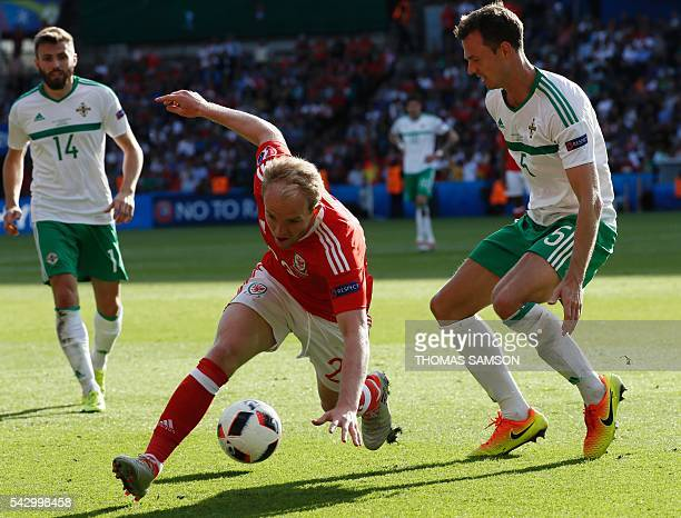 Wales' midfielder Jonathan Williams is marked by Northern Ireland's defender Jonny Evans during the Euro 2016 round of sixteen football match Wales...