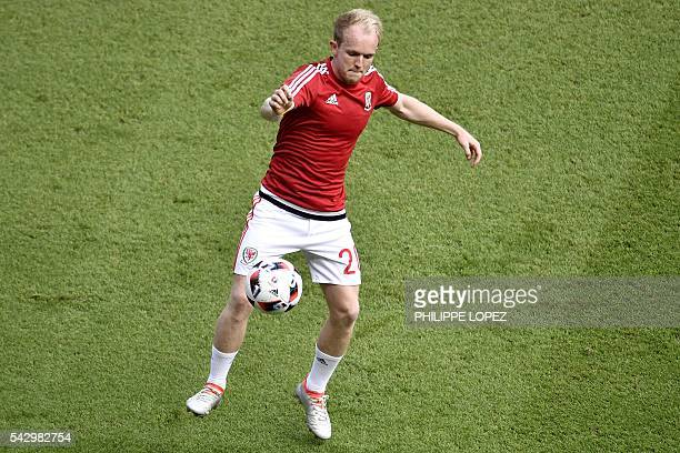 Wales' midfielder Jonathan Williams warms up prior to the start of the during Euro 2016 round sixteen football match Wales vs Northern Ireland on...