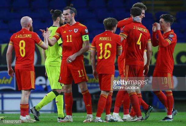 Wales' midfielder Jonny Williams and Wales' midfielder Gareth Bale celebrate after the FIFA World Cup Qatar 2022 qualification football match between...