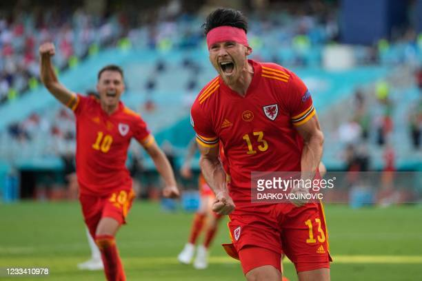 Wales' midfielder Kieffer Moore celebrates after scoring the equaliser during the UEFA EURO 2020 Group A football match between Wales and Switzerland...