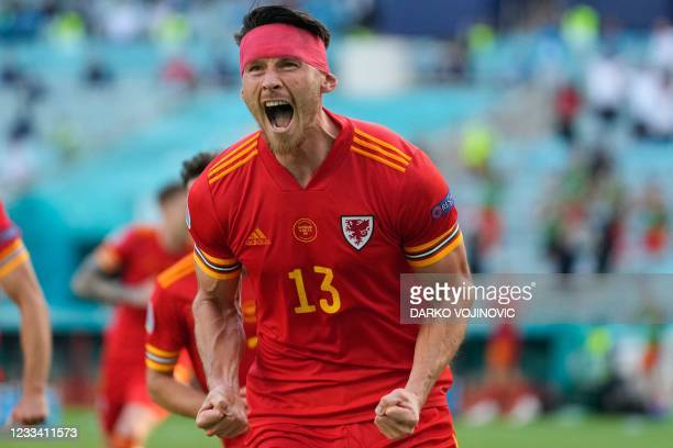Wales' midfielder Kieffer Moore celebrates his equalising goal during the UEFA EURO 2020 Group A football match between Wales and Switzerland at the...