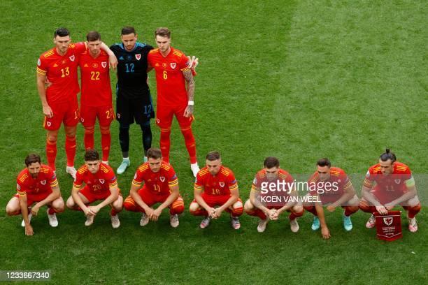 Wales' midfielder Kieffer Moore, defender Chris Mepham, goalkeeper Danny Ward, defender Joe Rodon midfielder Joe Allen, midfielder Daniel James,...