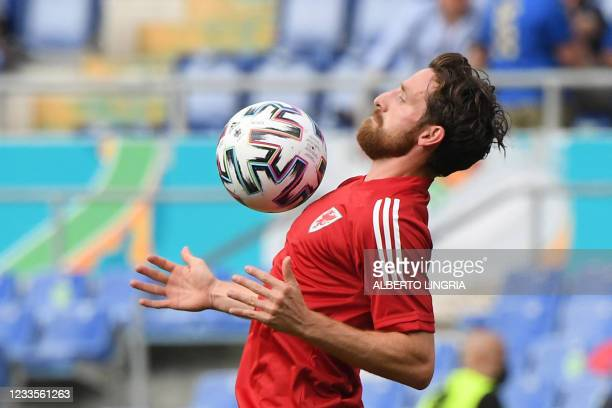 Wales' midfielder Kieffer Moore warms up prior to the UEFA EURO 2020 Group A football match between Italy and Wales at the Olympic Stadium in Rome on...