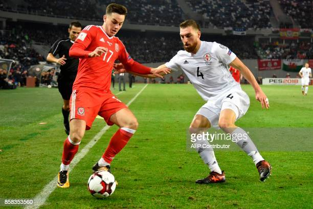 Wales' midfielder Tom Lawrence and Georgia's defender Guram Kashia vie for the ball during the FIFA World Cup 2018 qualification football match...