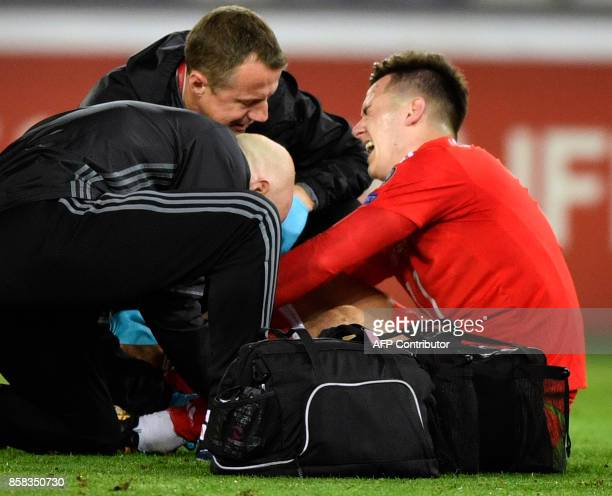 Wales' midfielder Tom Lawrence is helped by medics during the FIFA World Cup 2018 qualification football match between Georgia and Wales in Tbilisi...