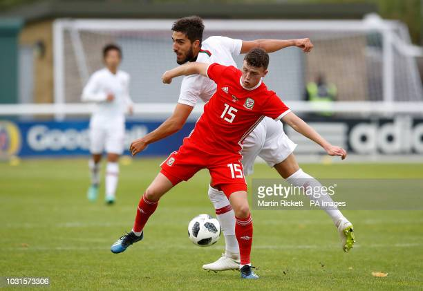 Wales' Nathan Broadhead battles for the ball with Portugal's Jorge Fernandes during the UEFA Euro Under 21 qualifying group eight match at Bangor...