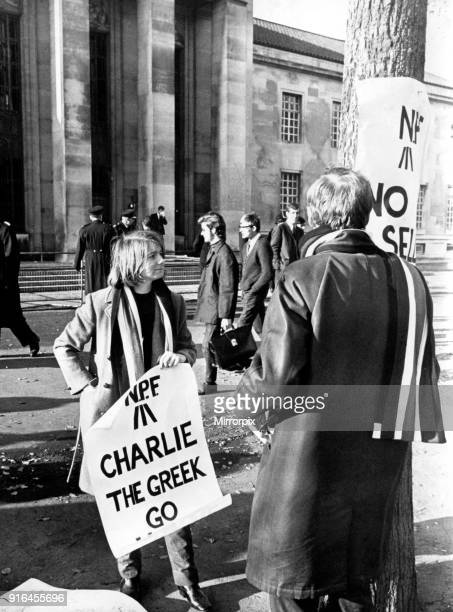 Wales Nationalist demonstrators outside the Temple of Peace with placards, before the arrival of Lord Snowdon. Cardiff, 17th November 1967.