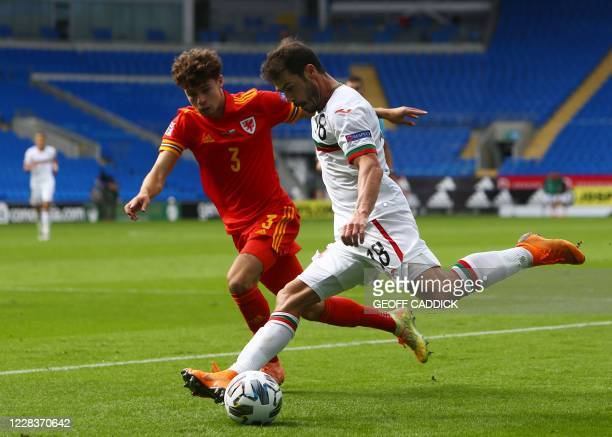 Wales' Neco Williams closes in on Bulgaria's midfielder Galin Ivanov during the UEFA Nations League football match between Wales and Bulgaria at the...