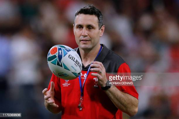Wales' new attack coach Stephen Jones holds a ball prior to the Japan 2019 Rugby World Cup Pool D match between Wales and Georgia at the City of...