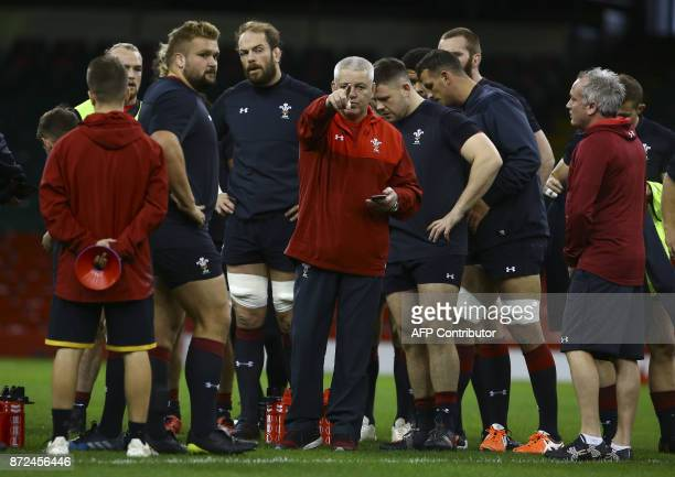 Wales' New Zealand coach Warren Gatland instructs the Wales' players at a training session at the Principality Stadium in Cardiff on November 10...