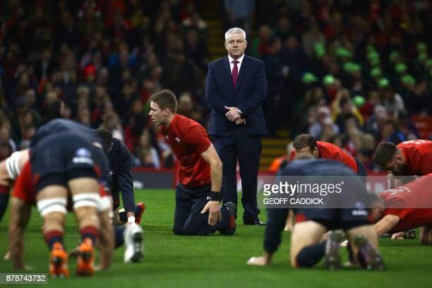 Wales' New Zealand Head Coach Warren Gatland watches the warm upbefore the international rugby union test match between Wales and Georgia at...