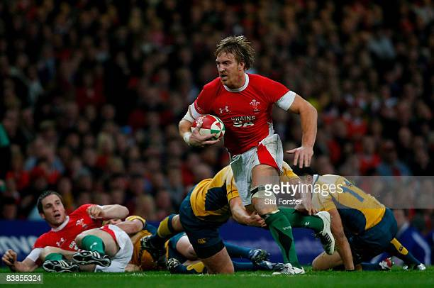 Wales number 8 Andy Powell runs through the Australian defence during the Invesco Perpetual Series match between Wales and Australia at the...