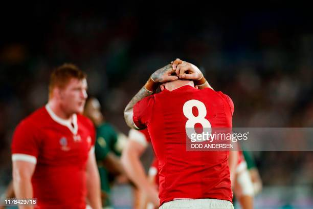 Wales' number 8 Ross Moriarty reacts after losing the Japan 2019 Rugby World Cup semi-final match between Wales and South Africa at the International...