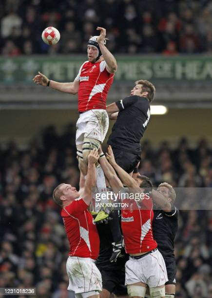 Wales' number 8 Ryan Jones wins the ball in the line-out ahead of New Zealand captain Richie McCaw during the Autumn International rugby union match...