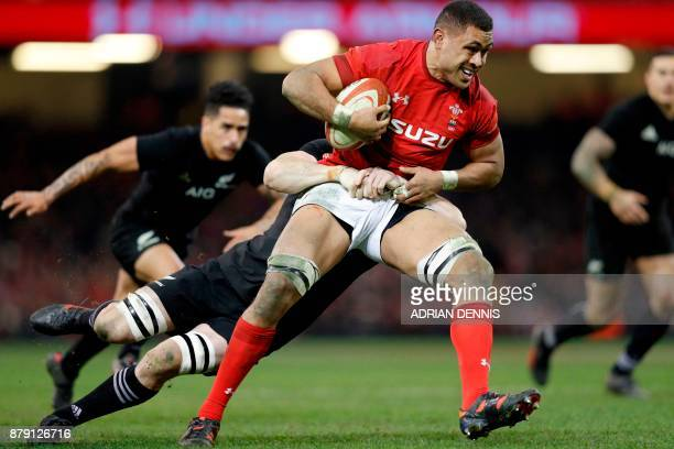 Wales' number 8 Taulupe Faletau gets tackled during the Autumn international rugby union Test match between Wales and New Zealand at the Principality...