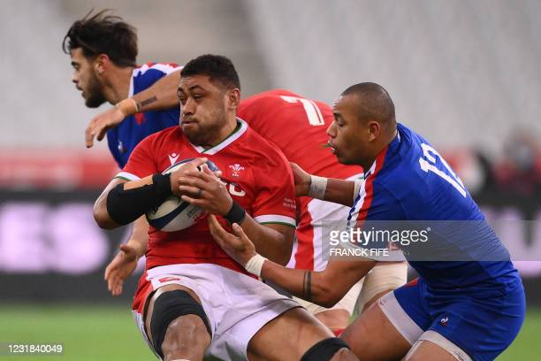 Wales' number 8 Taulupe Faletau is tackled by France's centre Gael Fickou during the Six Nations rugby union tournament match between France and...