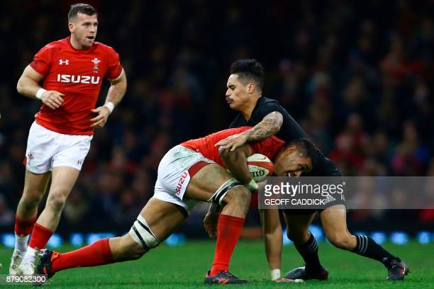 Wales' number 8 Taulupe Faletau is tackled by New Zealand's scrumhalf Aaron Smith during the Autumn international rugby union Test match between...