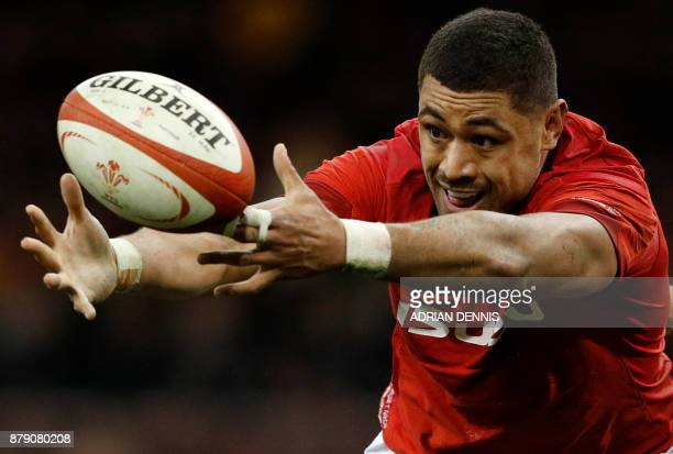 Wales' number 8 Taulupe Faletau stretches for a loose ball during the Autumn international rugby union Test match between Wales and New Zealand at...