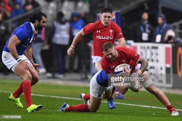 Wales' number eight Ross Moriarty is tackled during the Six Nations rugby union tournament match between France and Wales at the stade de France in...
