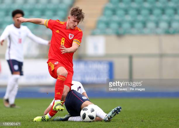 Wales' Oli Ewing tackled by England's Alex Robertson during the Under-18 International Friendly match at the Leckwith Stadium, Cardiff. Picture date:...