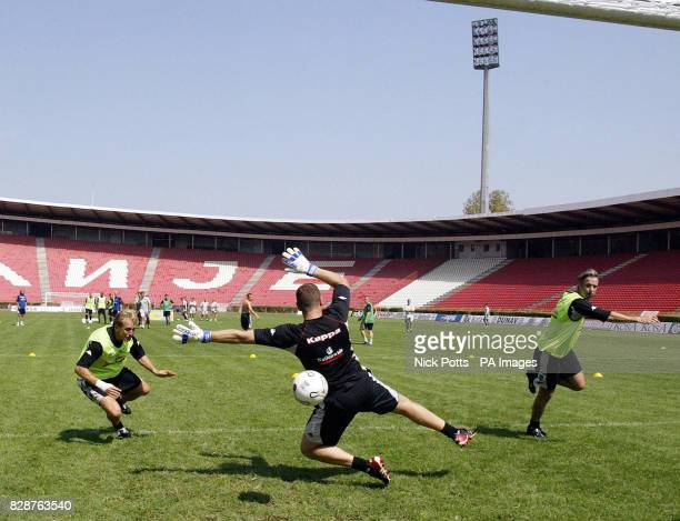 Wales' Paul Trollope Paul Jones and Kit Symons in action during a training session at Red Star Belgrade Stadium ahead of tomorrow's European...