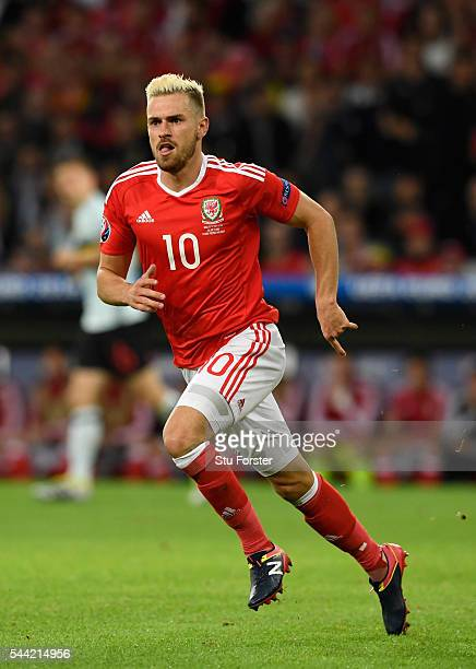 Wales player Aaron Ramsey in action during the UEFA Euro 2016 Quarter Final match between Wales and Belgium at Stade PierreMauroy on July 1 2016 in...