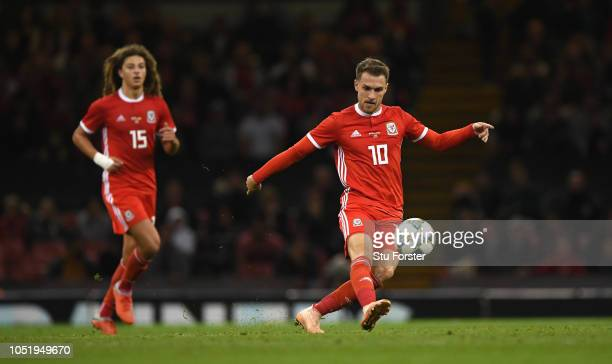 Wales player Aaron Ramsey in action watched by Ethan Ampadu during the International Friendly match between Wales and Spain on October 11 2018 in...
