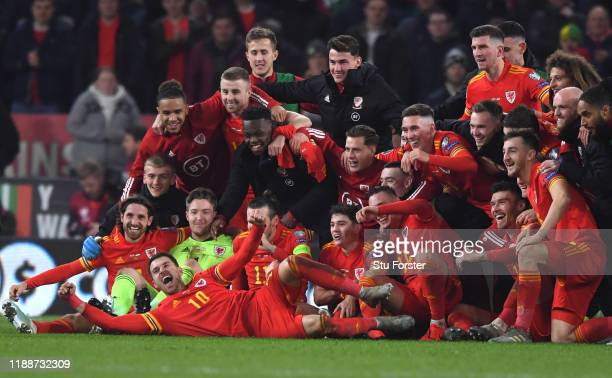 Wales player Aaron Ramsey joins in the celebrations with his team mates after the UEFA Euro 2020 qualifier between Wales and Hungary at Cardiff City...