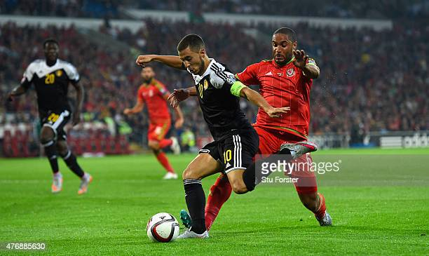 Wales player Ashley Williams challenges Eden Hazard of Belguim during the UEFA EURO Group B 2016 Qualifier between Wales and Belguim at Cardiff City...