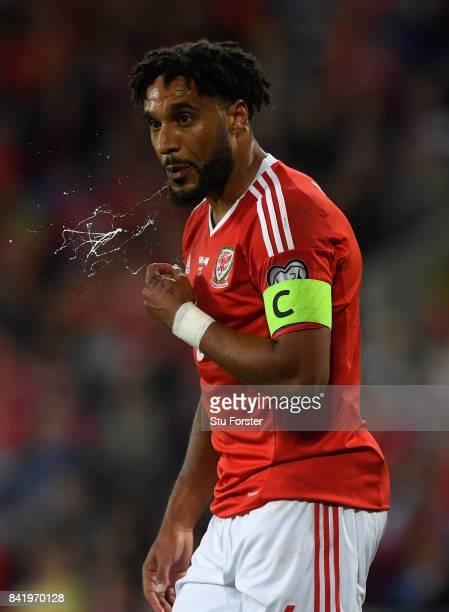 Wales player Ashley Williams spits during the FIFA 2018 World Cup Qualifier between Wales and Austria at Cardiff City Stadium on September 2 2017 in...