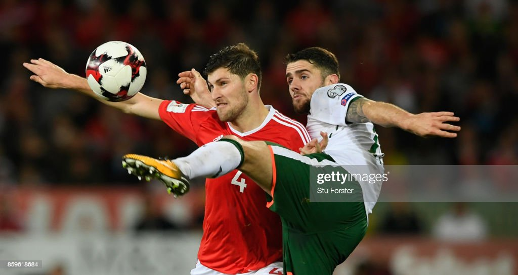 Wales player Ben Davies is challenged by Robbie Brady of Ireland during the FIFA 2018 World Cup Qualifier between Wales and Republic of Ireland at Cardiff City Stadium on October 9, 2017 in Cardiff, Wales.