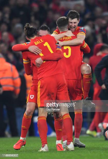 Wales player Ben Davies jumps into the arms of Chris Mepham to celebrate after the UEFA Euro 2020 qualifier between Wales and Hungary at Cardiff City...