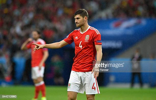 Wales player Ben Davies reacts after being yellow carded during the UEFA Euro 2016 Quarter Final match between Wales and Belguim at Stade...