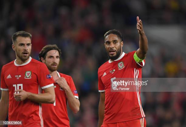 Wales player captain Ashley Williams reacts to Aaron Ramsey and Joe Allen during the UEFA Nations League B group four match between Wales and...