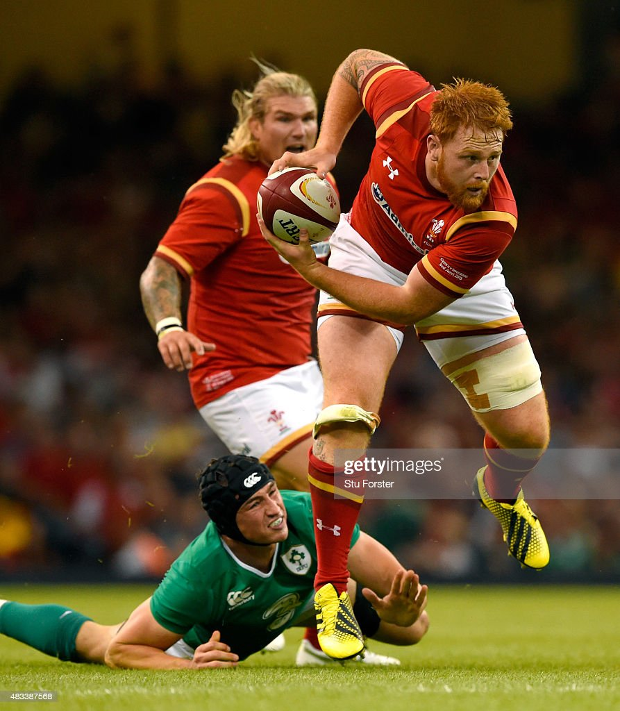 Wales player Dan Baker breaks the tackle of Ireland player Tommy O' Donnell during the Rugby World Cup warm up match between Wales and Ireland at Millennium Stadium on August 8, 2015 in Cardiff, Wales.