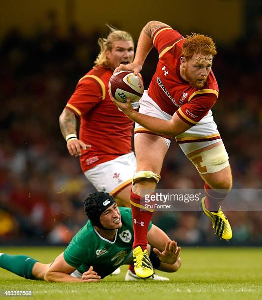 Wales player Dan Baker breaks the tackle of Ireland player Tommy O' Donnell during the Rugby World Cup warm up match between Wales and Ireland at...