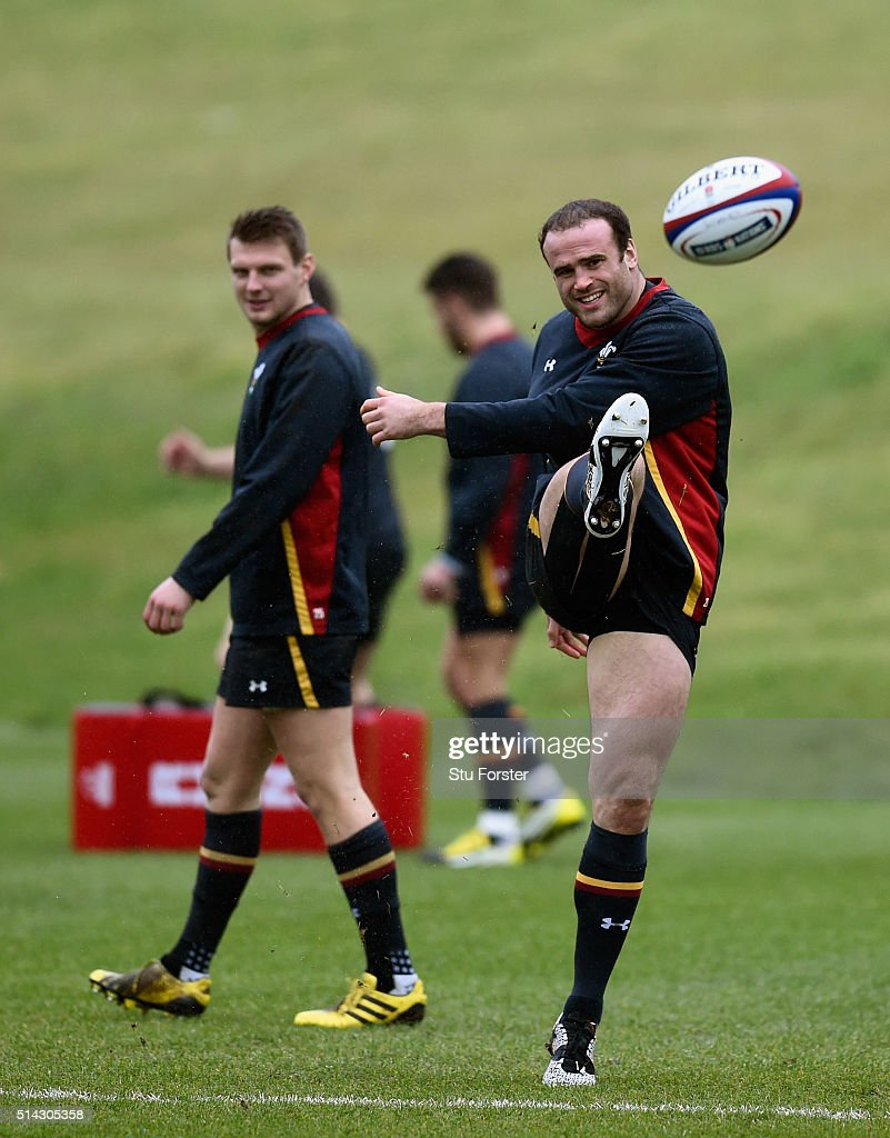 Wales player Dan Biggar looks on as Jamie Roberts kicks the ball during training ahead of their RBS Six Nations match against England, at The Vale Hotel on March 8, 2016 in Cardiff, Wales.