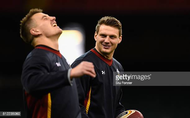 Wales player Dan Biggar shares a joke with Jonathan Davies during the Wales captain's run ahead of their RBS Six Nations match against France at...