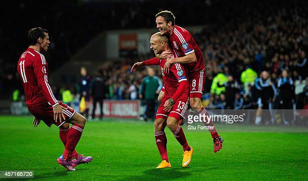 Wales player David Cotterill celebrates his opening goal with Gareth Bale and Andy King during the EURO 2016 Qualifier match between Wales and Cyprus...