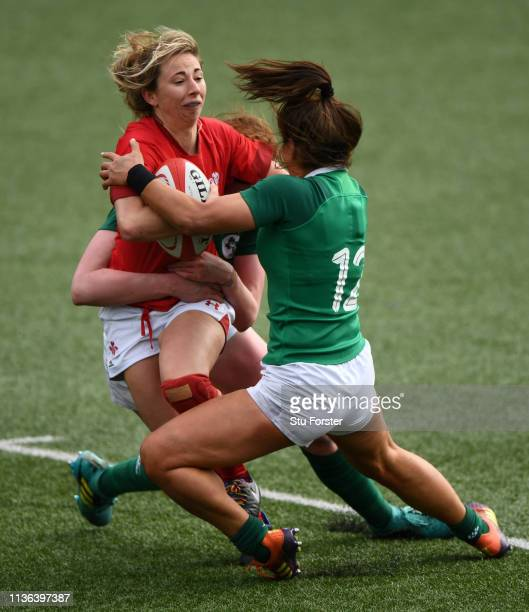 Wales player Elinor Snowsill is tackled by Sene Naoupu of Ireland during the Wales Women v Ireland Women match in the Women's Six Nations at Cardiff...