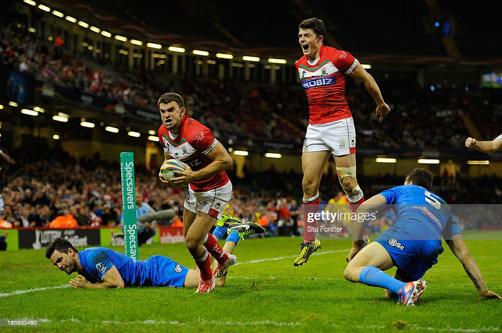 Wales player Elliot Kear (l) celebrates his try during the Rugby League World Cup Inter-group Match between Wales and Italy at Millennium Stadium on October 26, 2013 in Cardiff, Wales.