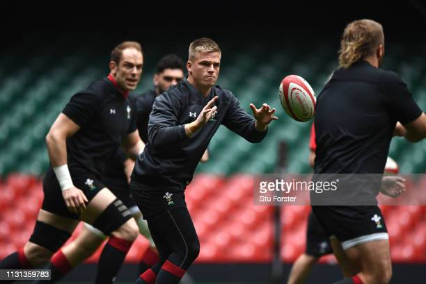 Wales player Gareth Anscombe gets ready to receive the ball as captain AlunWyn Jones looks on during Wales training ahead of the Six Nations match...