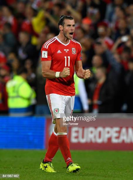 Wales player Gareth Bale celebrates after the FIFA 2018 World Cup Qualifier between Wales and Austria at Cardiff City Stadium on September 2 2017 in...