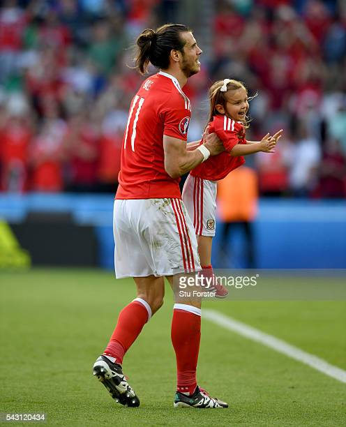 Wales player Gareth Bale celebrates with daughter Aba Violet after the Round of 16 UEFA Euro 2016 match between Wales and Northern Ireland at Parc...